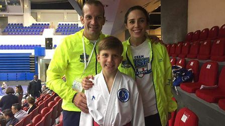 Luca Veras (centre) with his father and coach Raphael Veras (left) and Team USF French Coach Stephan