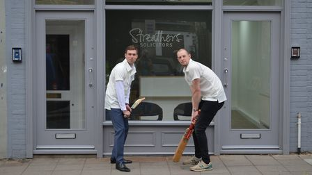 North London captain Sam Bardon (right) outside shirt sponsors Streathers Solicitors of Crouch End w