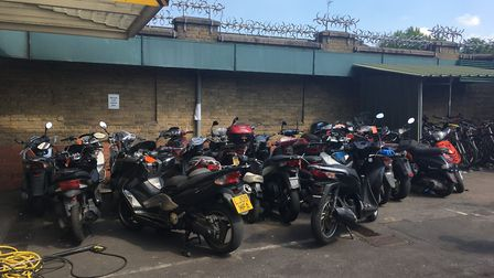 The 'showroom' of stolen mopeds at Islington Police Station. Picture: James Morris