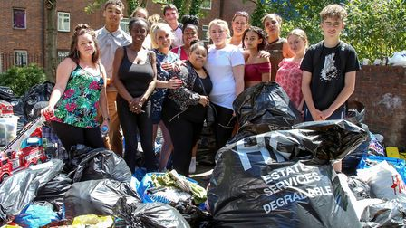 Neighbours from the Elthorne Estate sorting the donations for Grenfell Tower. Picture: CATHERINE DAV