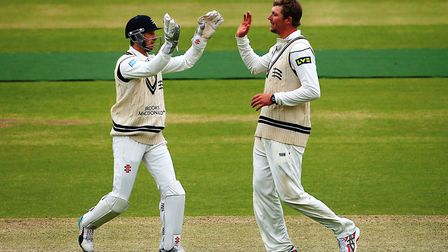 Middlesex's Ollie Rayner (right) celebrates a wicket with team-mate John Simpson