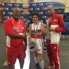 Islington's Sunni Torgman with coaches John Richards and Jerry Mitchell after winning gold at the Ha