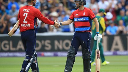 Middlesex batsman Dawid Malan (right) is congratulated on reaching a half century for England by Ale