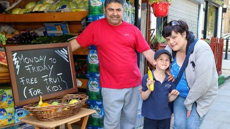 Yusuf Dogan, co-owner of Express Supermarket in Hazellvile Road, with Anthony Bryant and his mum Ire