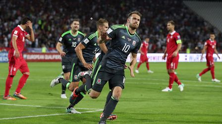 Wales' Aaron Ramsey (centre) celebrates scoring from the penalty spot against Serbia (pic Simon Coop