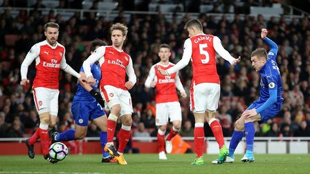 Leicester City's Jamie Vardy (right) attempts a shot against Arsenal during the Premier League match