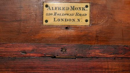 The Alfred Monk maker's sign at the top of the organ in St Thomas the Apostle Church, Finsbury Park.