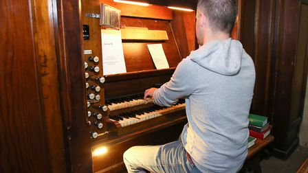 Andrew Greer plays the organ in St Thomas the Apostle Church, Finsbury Park. Picture: Catherine Davi