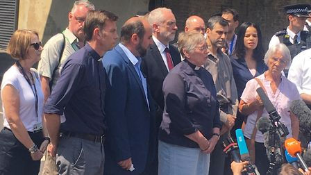 Islington faith and community leaders, including Jeremy Corbyn, gather under the Seven Sisters Road