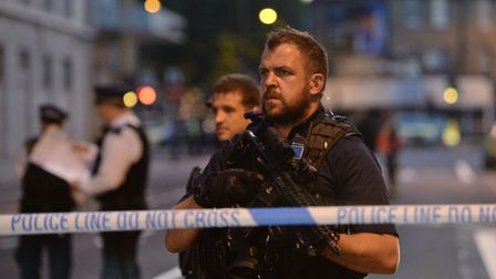 Armed police officers man a cordon at the scene of the collision. Picture: Victoria Jones/PA Wire