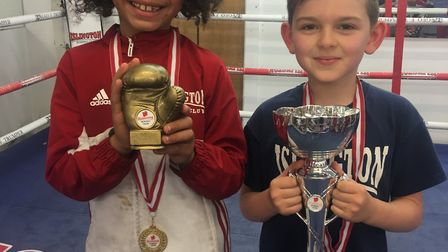 Maddox Pommells and Benjamin Wotton show off their trophies at Islington (pic Reggie Hagland)
