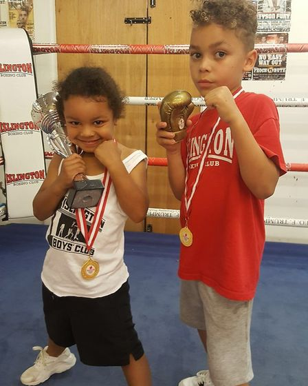 Cassian Campbell and Bleau Tucker show off their trophies at Islington (pic Reggie Hagland)