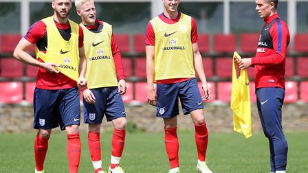 Arsenal's Calum Chambers (left) and Rob Holding (second right) on England under-21s duty (pic Marti