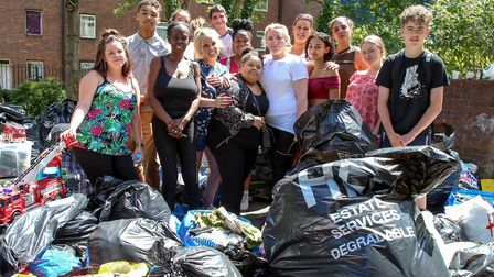 Volunteers sort through donations at St John's Community Centre for victims of the Grenfell Tower di
