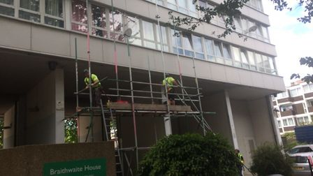 Contractors removing the cladding from Braithwaite House off Old Street. Picture: Tom Horton