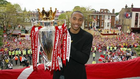 'Invincible' Thierry Henry holds the Premier League trophy in front of thousands of Gooners at Islin