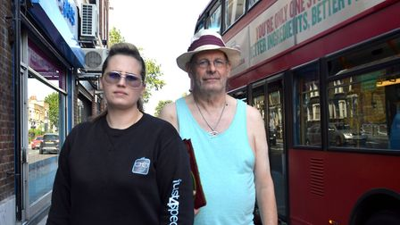 Emma Krestin of Just4Specs and Second Chance charity shop volunteer Peter Cooney stand outside their