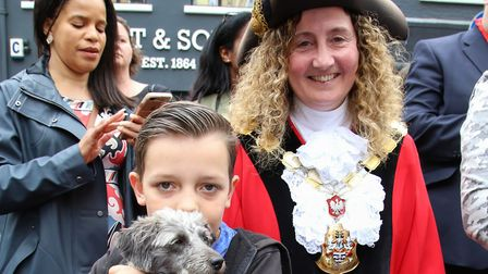 Franklin McLauthlin, nine, with border terrier cross mini poodle Nugget, two, and Mayor of Islington