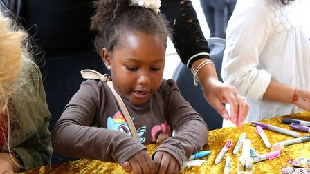 Adaroa Oba, five, paints a rock at a craft stall at Whitecross Street Party. Picture: Catherine Davi