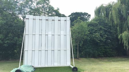 A sightscreen stands beyond the boundary