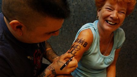 GMB president Mary Turner receiving a temporary tattoo from Camden tattooist Naresh, to mark the tat