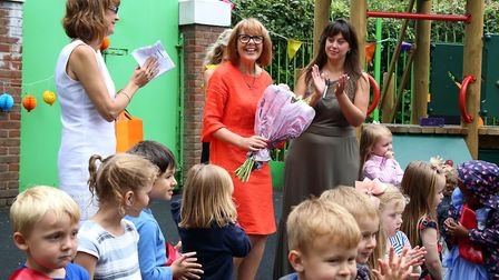 Pauline Davis is presented with a bunch of flowers to mark the 40th birthday. Picture: Catherine Dav
