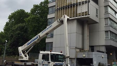 The cladding being removed from Braithwaite House. Picture: Terry Stacy