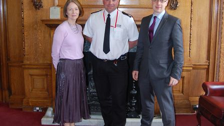 Paul Hobbs, London Fire Brigade's borough commander for Islington, centre, is greeted by Islington C