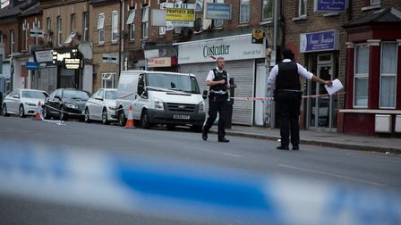 Willesden Road was cordoned off following a fight which saw four men arrested (Picture: Jonathan Go