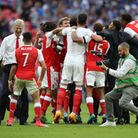 Arsenal manager Arsene Wenger celebrates with Alexis Sanchez after the FA Cup final (pic Nick Potts/