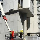 The first panel being removed from Braithwaite House, Bunhill Row. Picture: Islington Council