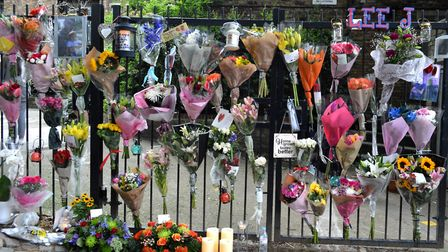 The gates of Morland Mews covered in floral tributes. Picture: Polly Hancock