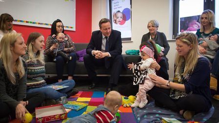 Prime Minister David Cameron meets parents and their children at a pre-natal class run by Islington'