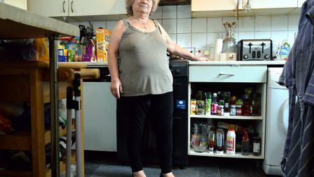 Panayiota Christou in the kitchen of her damp-ridden Earlstoke Estate flat. Picture: Polly Hancock