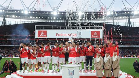 The Arsenal squad celebrate after the match between Arsenal and Wolfsburg at Emirates Stadium two ye