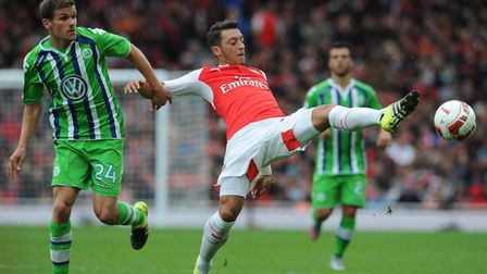 Mesut Ozil during the Emirates Cup. Photo by Stuart MacFarlane/Arsenal FC via Getty Images
