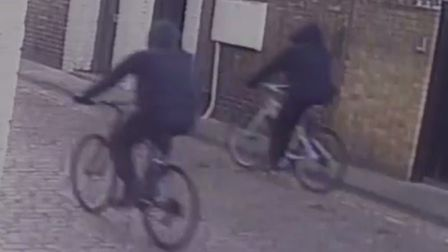 CCTV footage of two men on bicycles police want to talk to. Picture: Met Police