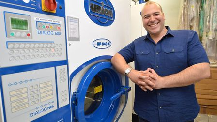 Yani Zertalis with the organic dry cleaning machine at Universal Dry Cleaners in Brecknock Road. Pic