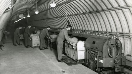 Post office underground railway: workers load the train. Picture: Royal Mail