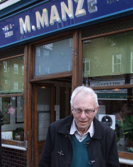 Dennis outside Manze's, his favourite pie and mash shop from his Highbury days.