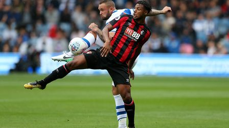 Queens Park Rangers' Joel Lynch in action with Bournemouth's Lys Mousset (pic: Scott Heavey/PA)
