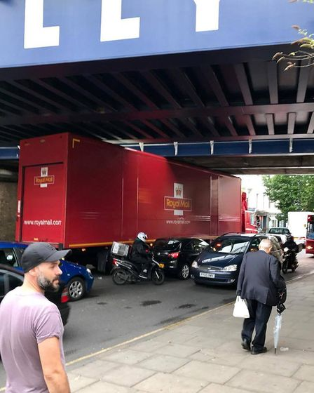 The vehicle got stuck during rush hour on Friday. Picture: Duncan Hamilton