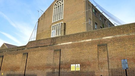 A photo taken last year shows no netting between the three top windows and Wheelwright Street at the