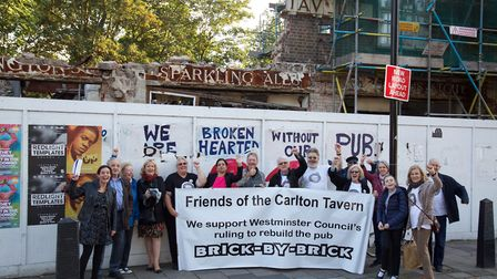 Local campaigners celebrate in March when it was firt signalled that work would begin to restore the