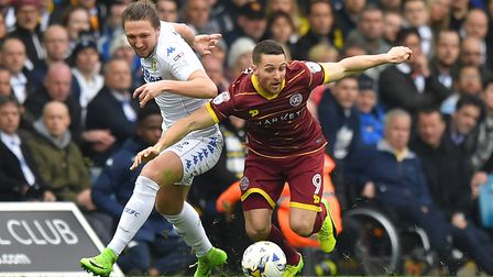 Conor Washington in action for Queens Park Rangers at Leeds United last season (pic: Dave Howarth/PA