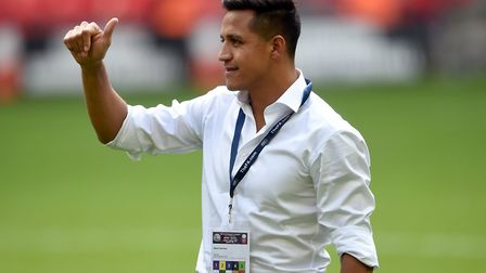 Arsenal's Alexis Sanchez acknowledges supporters after the team's Community Shield win over Chelsea