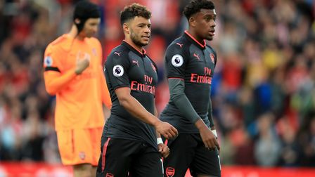 Arsenal's Alex Oxlade-Chamberlain and Alex Iwobi trudge off after defeat at Stoke (pic Mike Egerton/