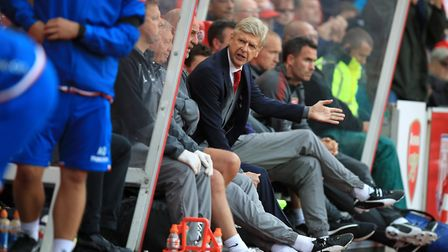 Arsenal manager Arsene Wenger gestures in the dugout at Stoke (pic Mike Egerton/PA)