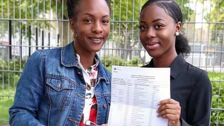 Diaz Gordon, 16, with mum Geena Gordon, after receiving two 6s in English Language and Literature in