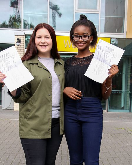 Masie Smith, left, who received three 7s in Maths and English, and Eniola Dada, who received the top
